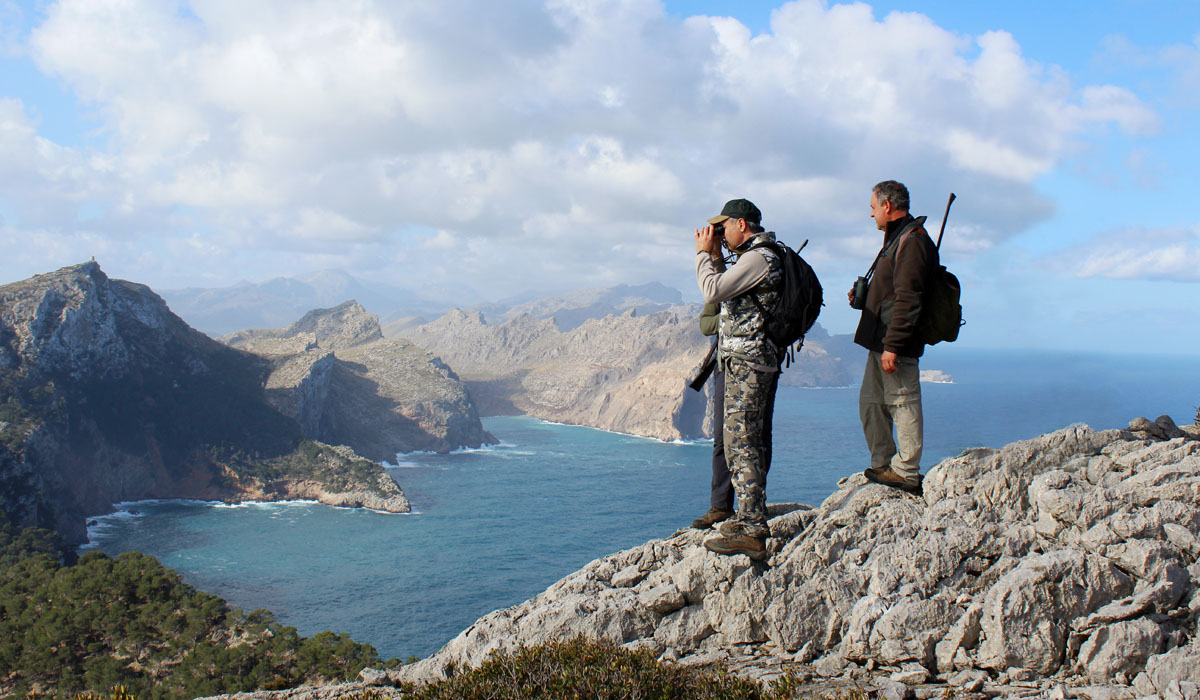 Three hunters with nice landscapes in the background when hunting the Balearean Boc in Mallorca