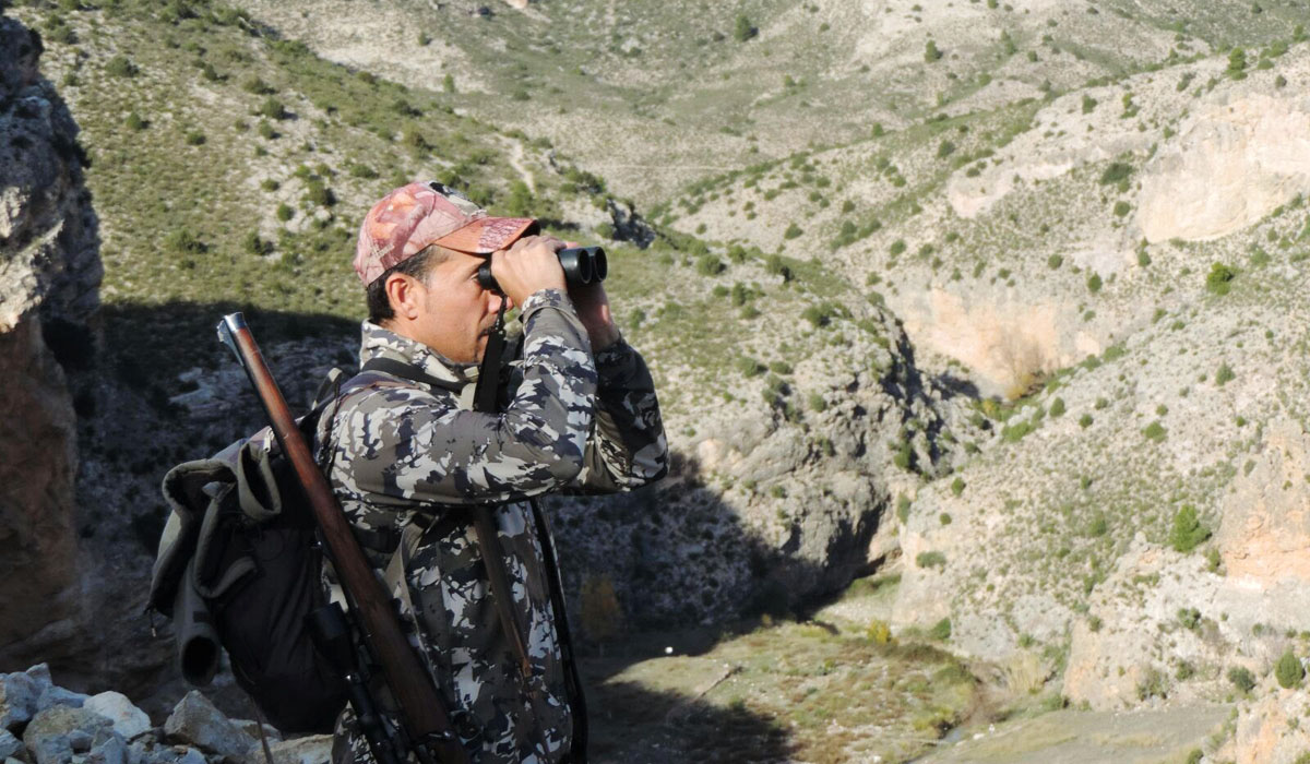 Pedro Pablo Alejandre professional hunter glassing with his binoculars in the Beceite Ibex area