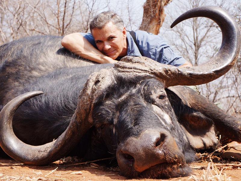 Hunter with a buffalo trophy in Zimbabwe