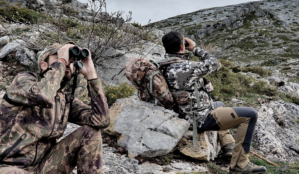 Two hunters glassing with their binoculars in the Cantabrian Chamois area
