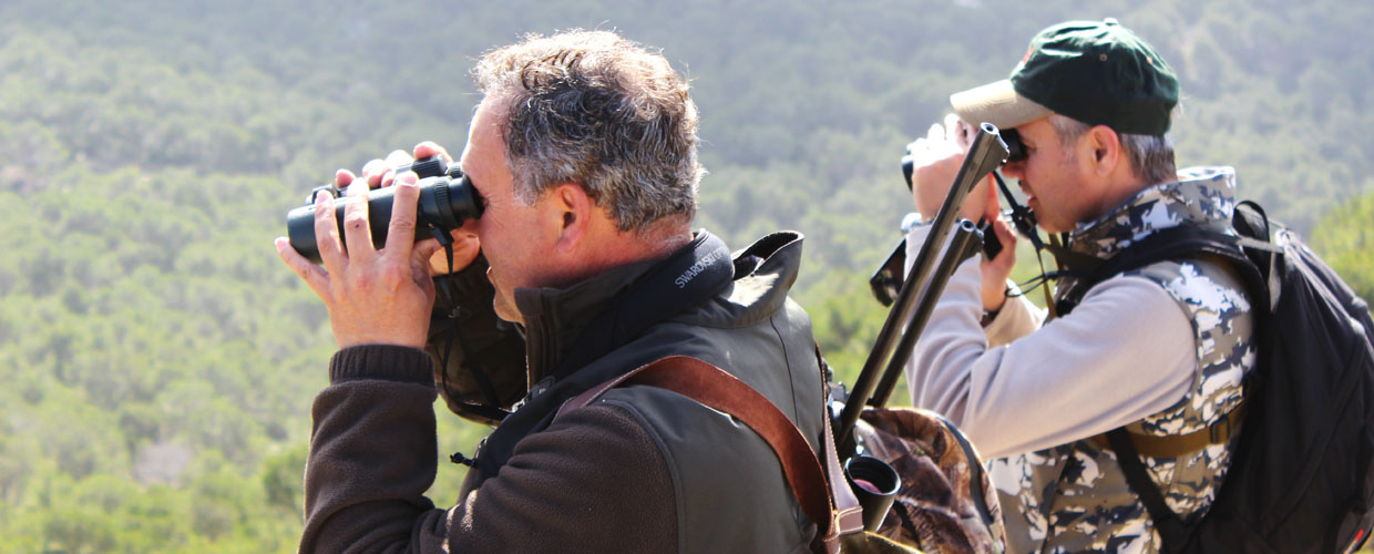 Two hunters glassing in Mallorca mountains Spain