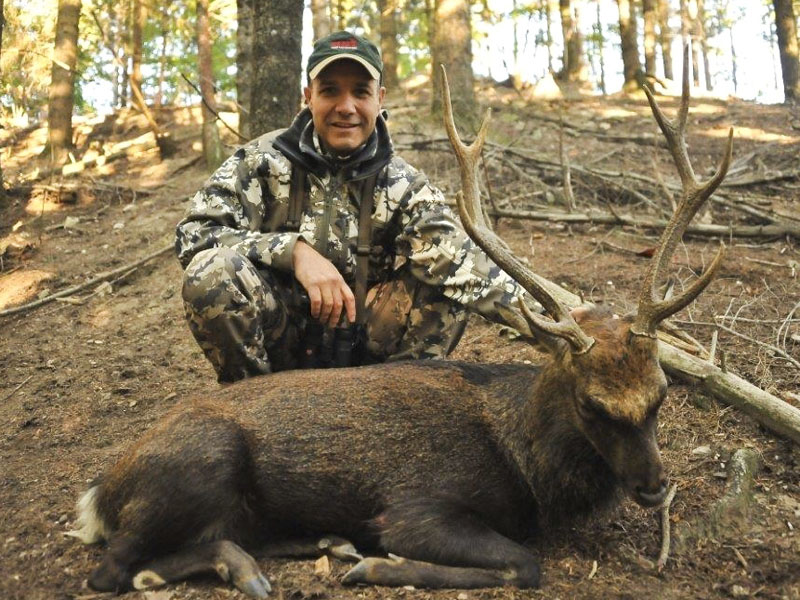 Hunter with a sika deer trophy in France