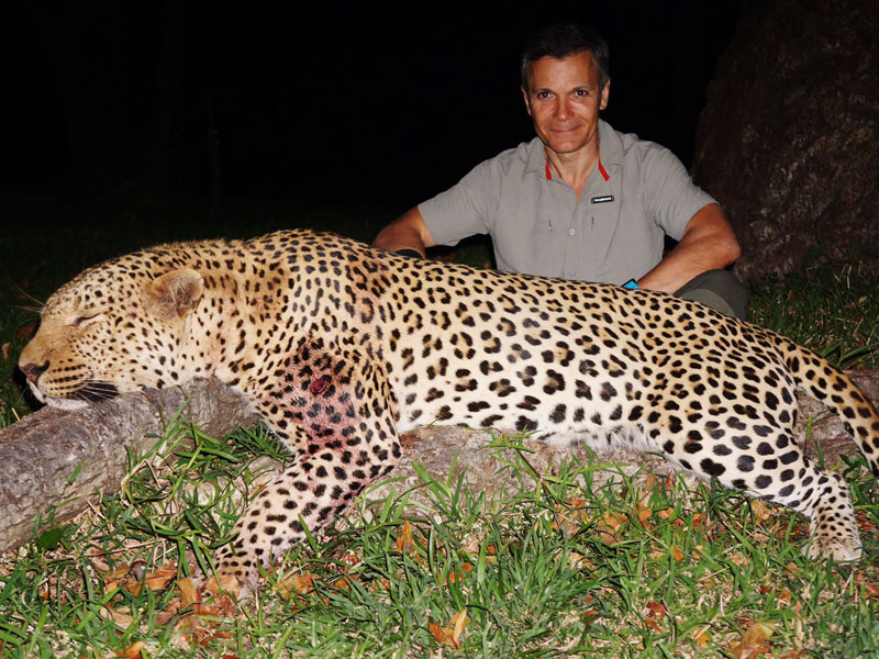 Hunter with a leopard trophy in Zimbabwe