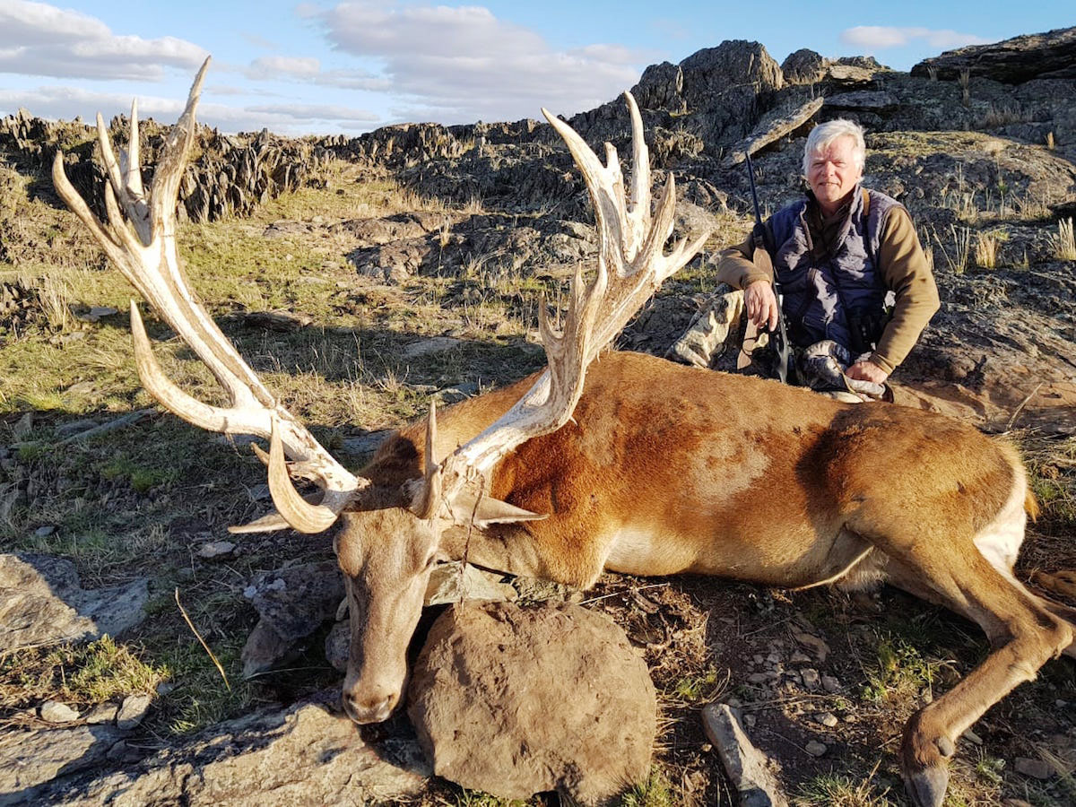 Hunter with a huge Red Stag trophy in Argentina